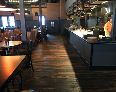 Craftsman Inn and Suites features unique flooring made from reclaimed old horse fencing with a custom charcoal finish, by Pioneer Millworks.