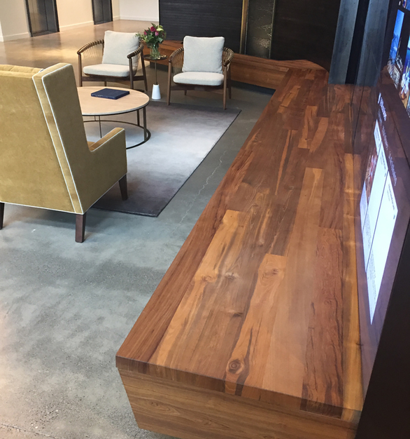 Reclaimed Teak Bright seating area built into this cruise line office space.