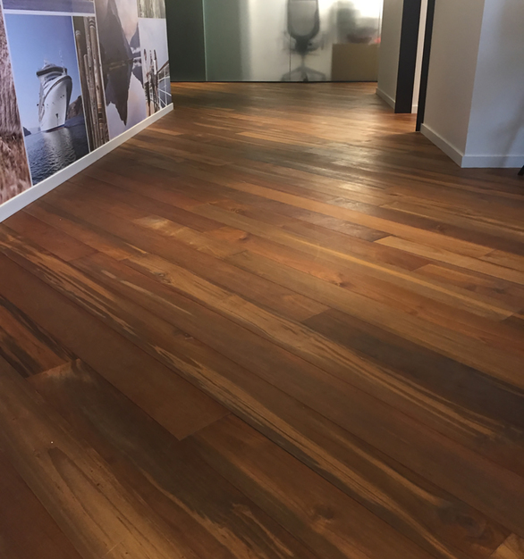 Reclaimed Teak Bright wood flooring flows throughout this cruise line's office space in Seattle, WA.