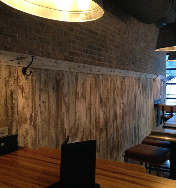 American Prairie Faux Painted paneling wraps around the lower half of this restaurant seating area.