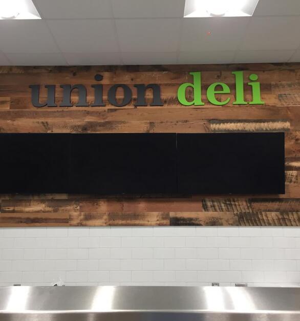 Pioneer Millworks reclaimed Grandma's Attic paneling at Union Market, Barry University Florida