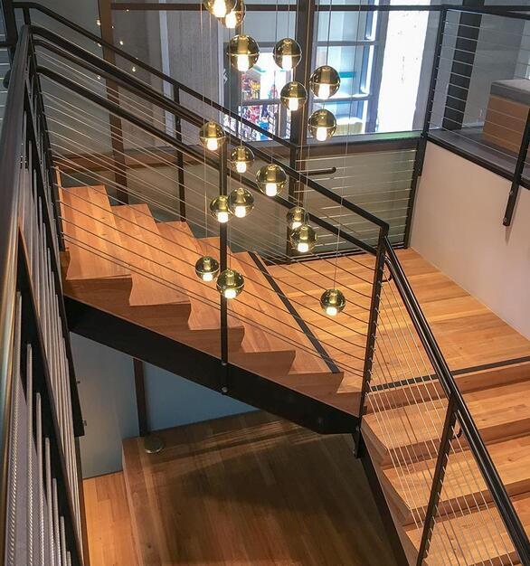 Pioneer Millworks reclaimed American Gothic Ash with poly and fire retardant used on stairs in San Fransisco, CA
