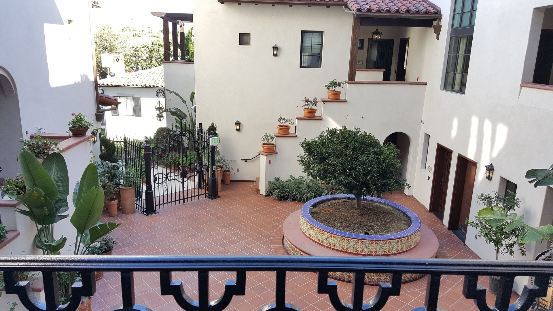 The cozy courtyard of the Plaza La Reina is complimented by the bronze finish on the windows and doors from St. Cloud Window.
