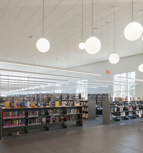 Suspended 25 feet from the ceiling throughout the library, Profile luminaires illuminate library shelving stacks, while also providing bright general lighting.