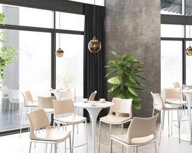 ZUO Modern used their Trente ceiling lamp in satin and amber located just behind the beautiful chairs and table.