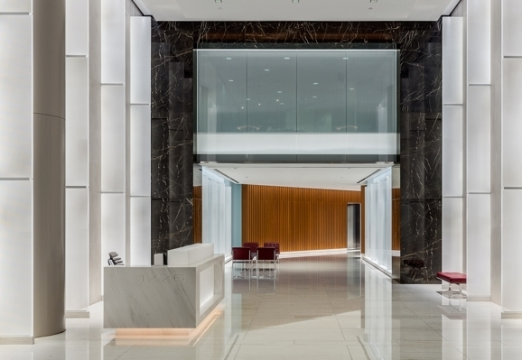 The Luma Series VO fixtures backlight the front panel of the reception desk in the main lobby of 1776 Eye Street.