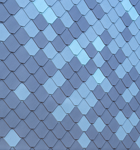 Close up view of Pure + FreeForms Aquamarine, Brushed Azure, and Light Grey Exterior Cladding Finish from their Bespoke Finishes Collection  Photography Credit: Josh Partee
