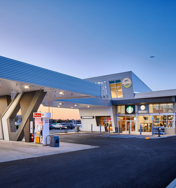 The design team of the Logan Airport Nouria Energy gas station opted for 3 collection finishes and 1 custom-designed finish for this project, all aligning with the intent to design with only high-quality, fully sustainable materials.  Photography Credit: Joseph Ferraro Photography