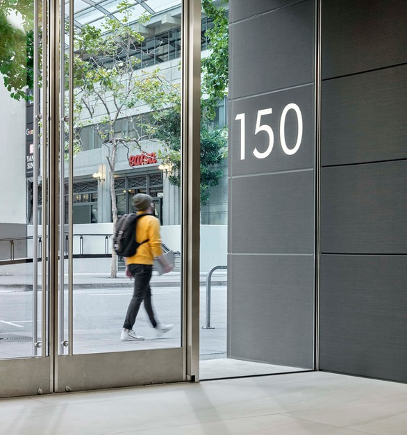 150 Spear Street features Pure + FreeForms Oxidized Silver Hairline on the building entrance, which flows into the interior lobby.  Photography Credit: Cesar Rubio