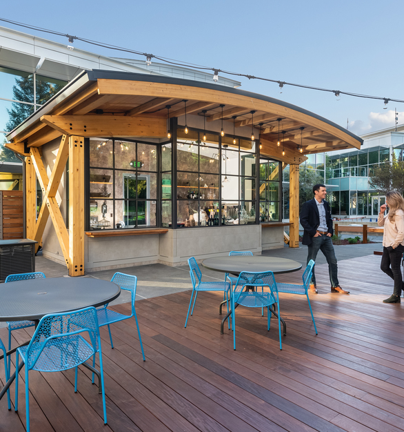 A unique application of Pure + FreeForms material, Deco Bronze clads the interior back walls of the kiosk outside of the PayPal's San Jose office.  Photography Credit: Bernardo Grijalva