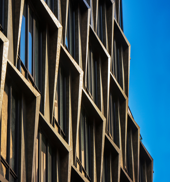 108 Chambers is a 10-story mixed use building in the Tribeca neighborhood of New York City. The unique facade features custom geometric angular slab/spandrel metal panel formations surrounding the windows on the entire exterior, customized to the architect's design.