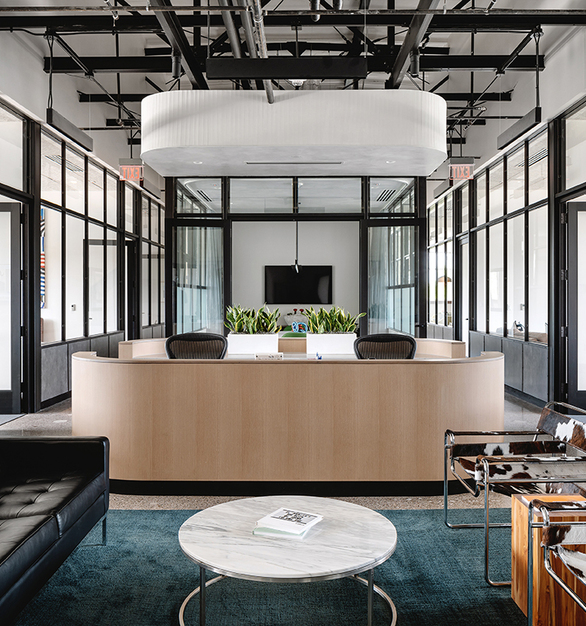 The light-filled Penrose office blends the necessities of office life with a residential inspired open concept floor plan.