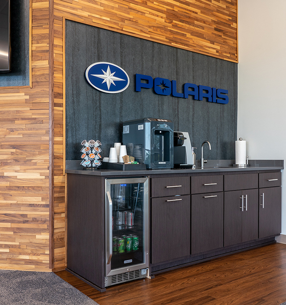 The focal point of the Polaris Hangar lobby is the Polaris Inc. logo itself, so the accent wall material needed to be textured and dynamic without being distracting. The solution was a small but beautiful application of our cool blackened steel finish, Frozen Titanium, showing that you can create dynamic visual interest without a ton of material.