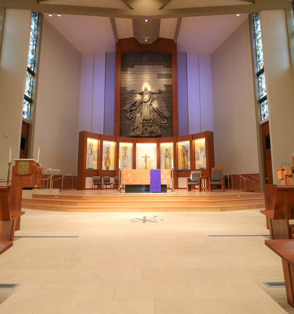 The design intent for the reredos at the St. Lawrence Martyr Church, was to incorporate metals that would react beautifully with light, creating a glow from just behind the altar. This was accomplished with 3 finishes, in varying panel widths and lengths, in controlled but random pattern ensuring visual interest while still capturing the natural light.