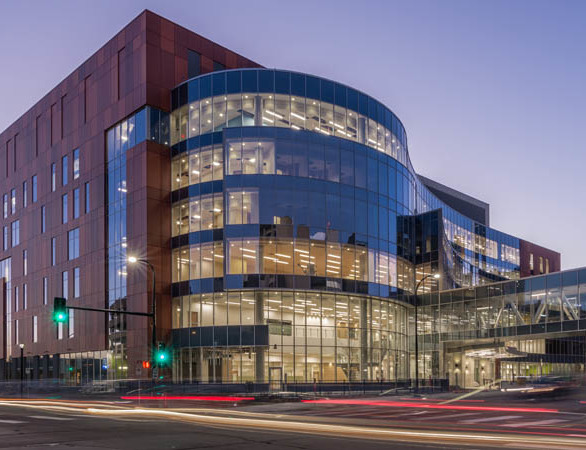 The Hennepin County Medical Center features an expansive glass curtain wall accompanied by modern aluminum wall panels.