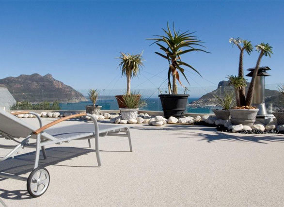 Quartz Carpet used their Modern Seamless Epoxy floor to create a relaxing outdoor space.