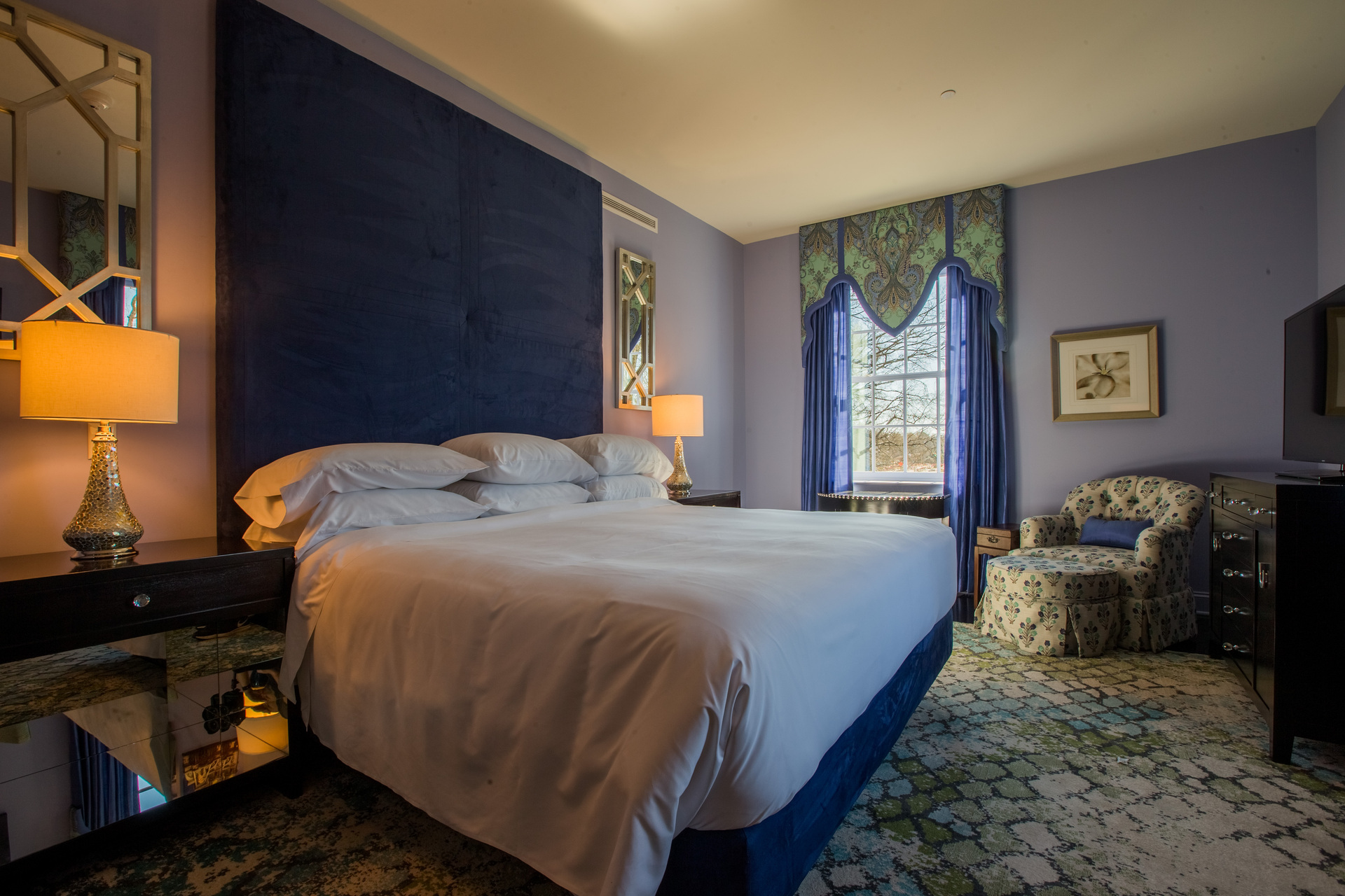 Stretch out on this comfy bed with a large upholstered headboard to relax and sleep well.  The hotel made sure to use sound-reducing drywall by QuietRock in all their rooms to create a quiet environment with little sound transferring between the rooms.