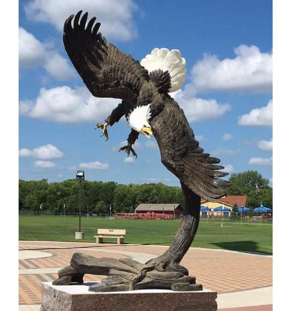 Bronze sculpture of an American Eagle Soaring Down onto a Tree Branch