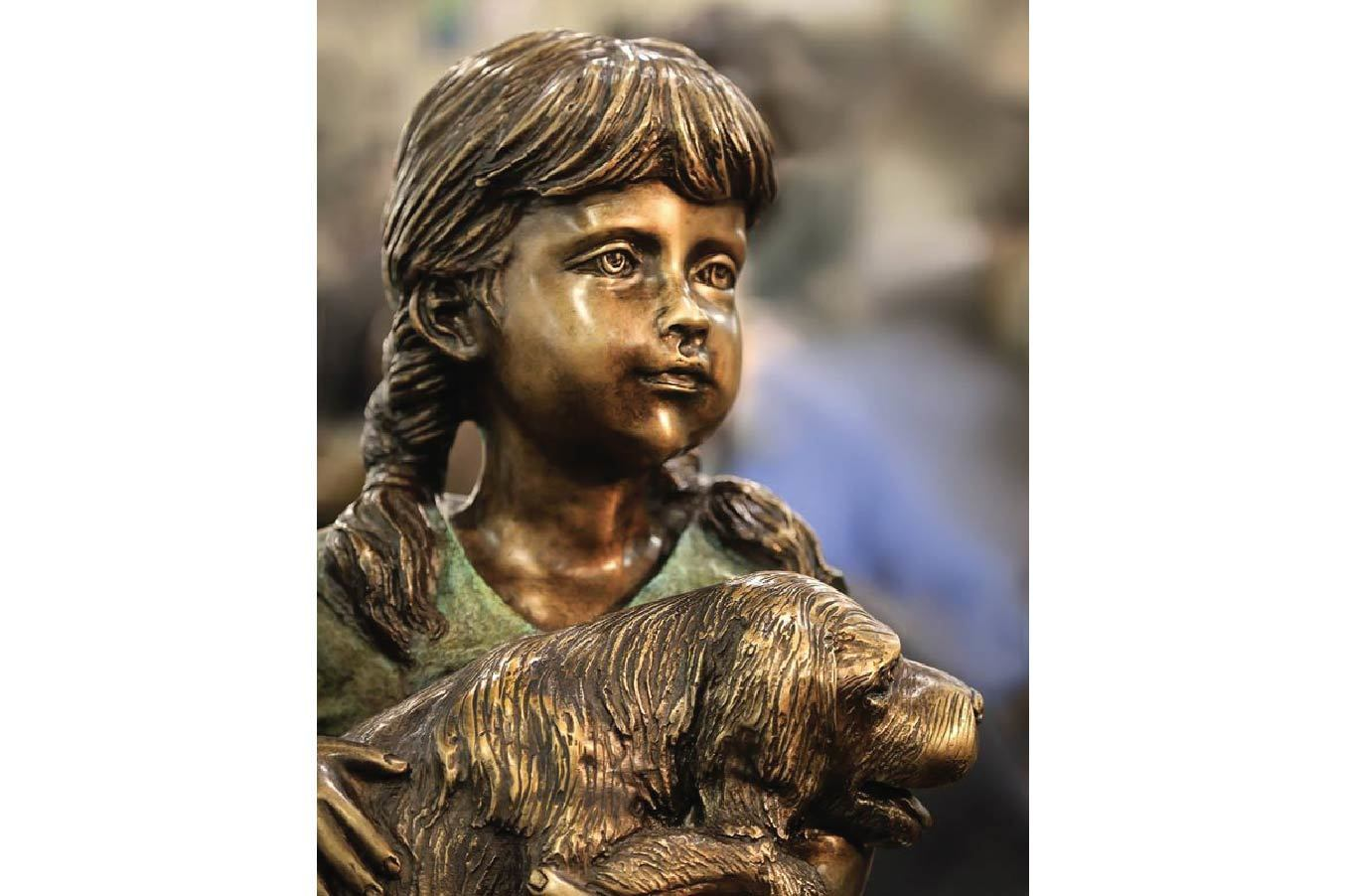 Adorable Bronze Sculpture of a Young Little Girl Holding a Puppy.