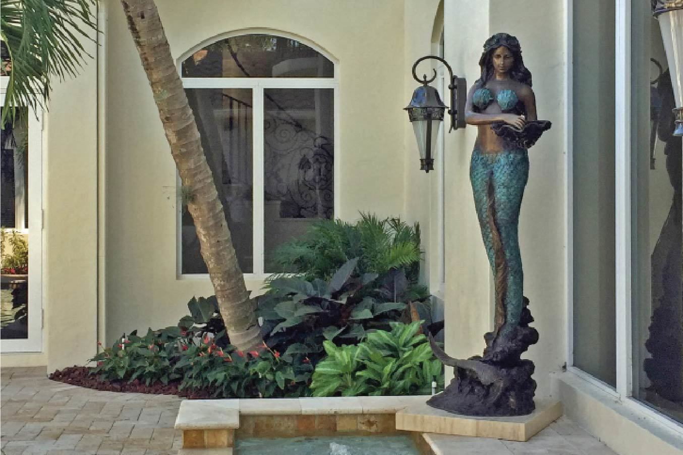 Beautiful bronze mermaid sculpture.