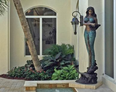 Beautiful bronze mermaid sculpture.
