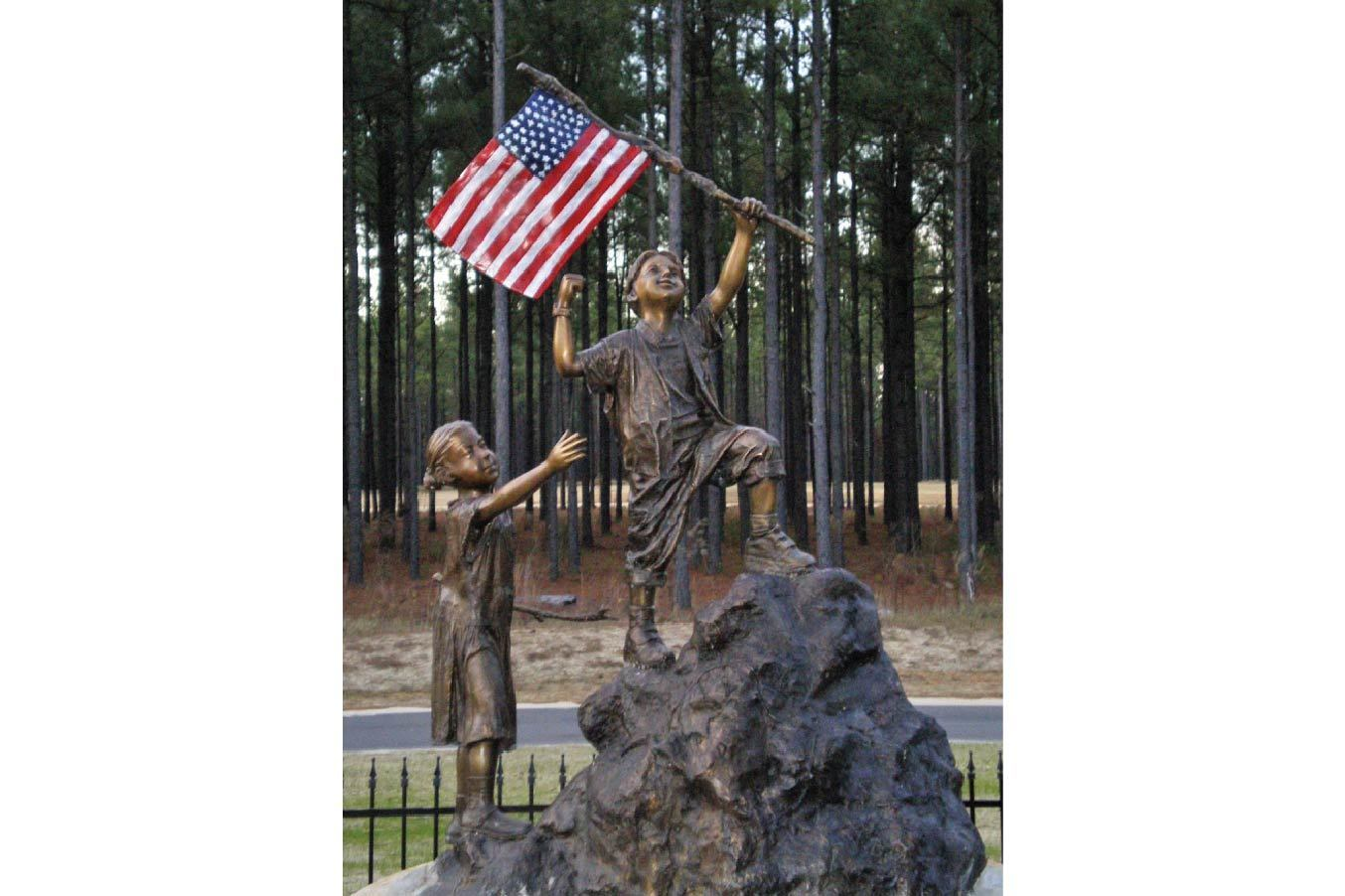 Detailed Bronze Statue of a Boy Holding the American Flag