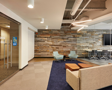 Interior of RBC Wealth Management Innovation Lab with open ceiling design and LED linear and pendent fixtures, by Emanuelson-Podas.