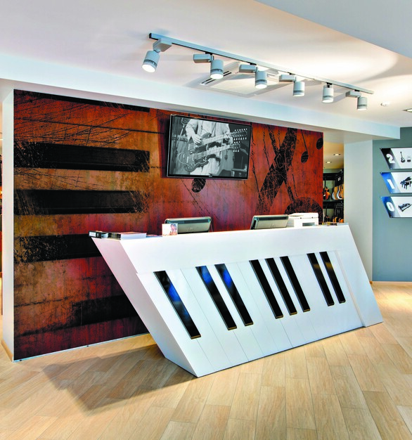 This reception area has a focal graphic design on the partition wall of this music shop, creating a welcoming feel.