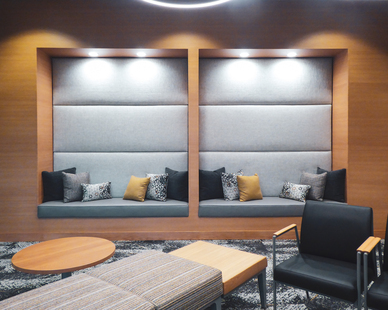 Cozy recessed bench seating with accent pillows complete this waiting area at Karmazin Dental Office designed by Lenae Design.