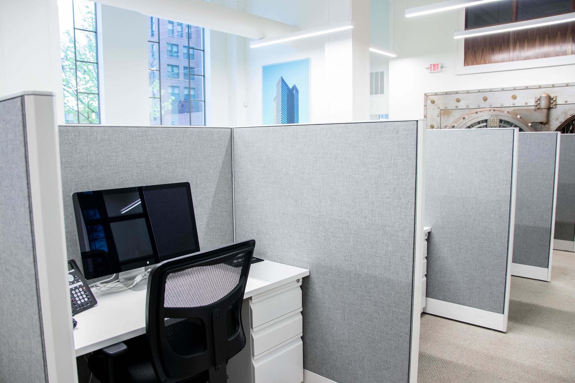 Open office work stations can be found on the main level of the new Mortarr HQ, renovated by Red Door Construction.