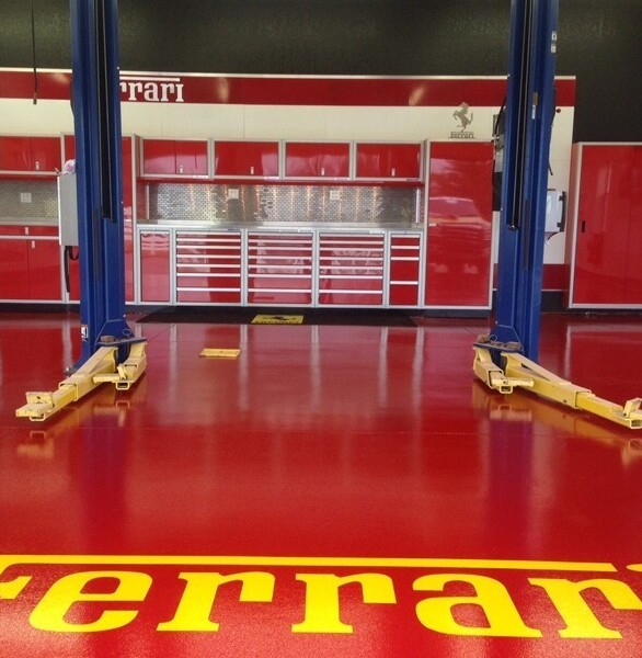 A Ferrari lovers dream garage with custom red Moduline Cabinets in PROII™ Series cabinets.
