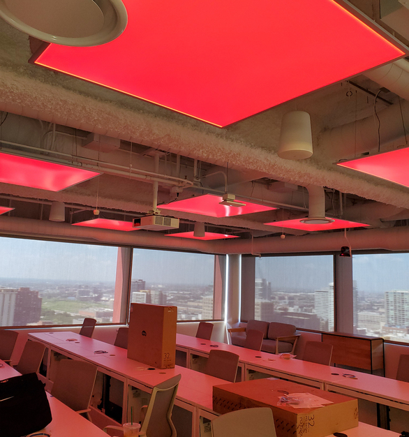 The global trading firm offices wanted to create an open, light and airy environment for employees. This meeting room utilizes LEDCONN LUXFIT™ RGB LED light panel, which creates a colorful ambiance for the space.