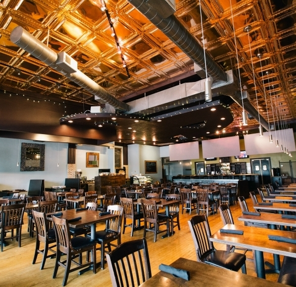 The gleaming decorative ceiling tiles creates an intimate setting in this bar and restaurant.
