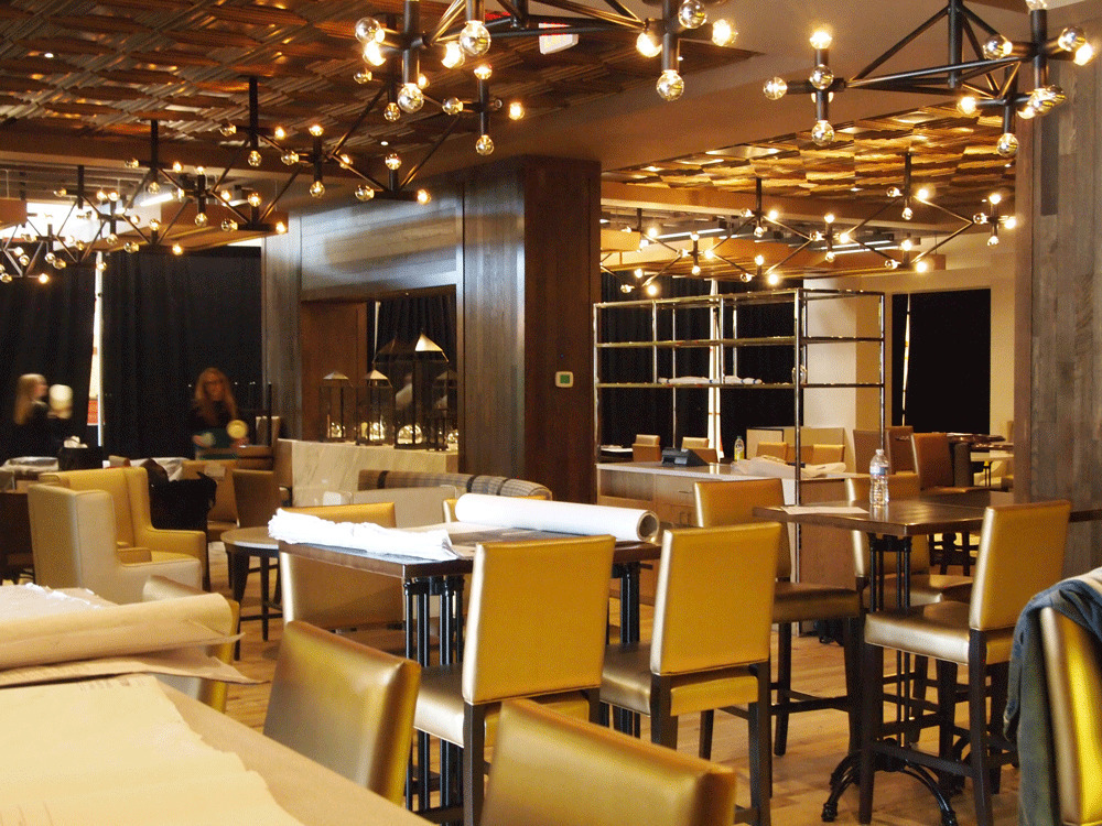 Enjoy the unique lighting and beautiful tin ceiling in this restaurant.