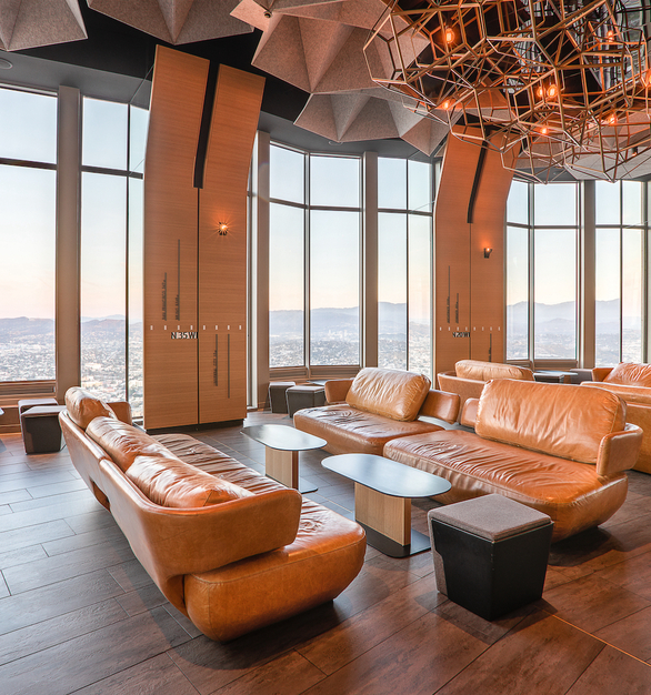 The large windows that provide 360 degree views of Los Angeles span over to the lobby and waiting area space at the restaurant. Complete with comfortable, modern couches and sculpture lighting, the waiting space has an ambiance as great as the dining area.