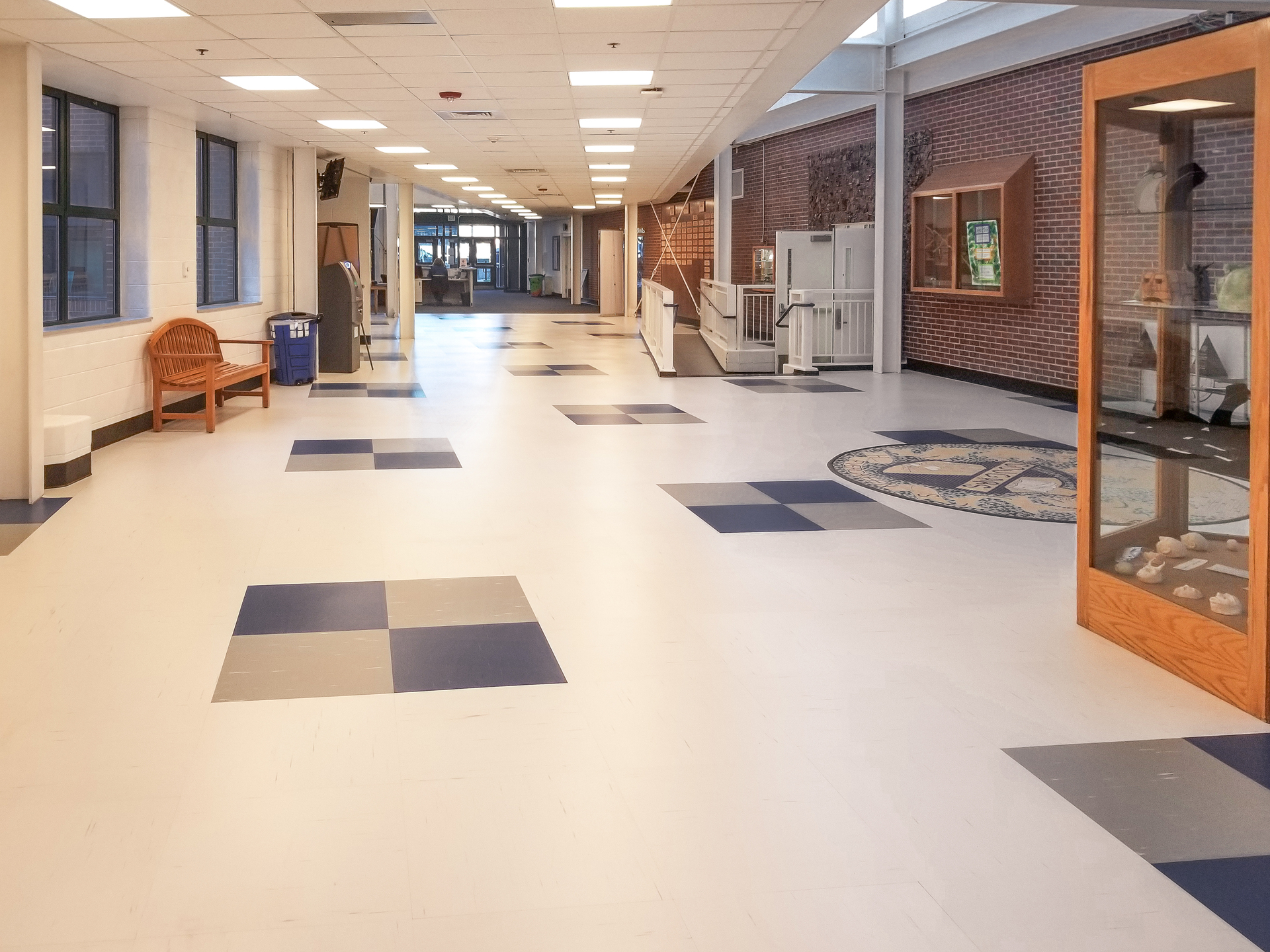The flooring throughout Evergreen High school features our Frost White, Mystic Silver and Royal Blue Rikett Quartz Tile. Our RQT line of quartz tile flooring manufactured with 70% natural quartz minerals, which make it a very hard, durable and dimensionally stable tile that will not break or tear like other quartz floor tiles. On the MOH's scale of hardness, Diamonds are the hardest mineral at 10. Quartz measures a 7 on the MOH's scale. The primary contents for VCT and LVT, Calcium Carbonate or Limestone, measure a 3. On the MOHs scale. Clearly, Quartz is the toughest resilient flooring material.