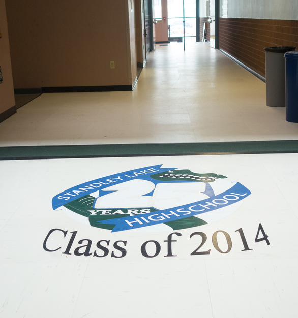 School branding can create a unique floor design with our quartz tiles. This was completed using waterjet cut RQT tiles.