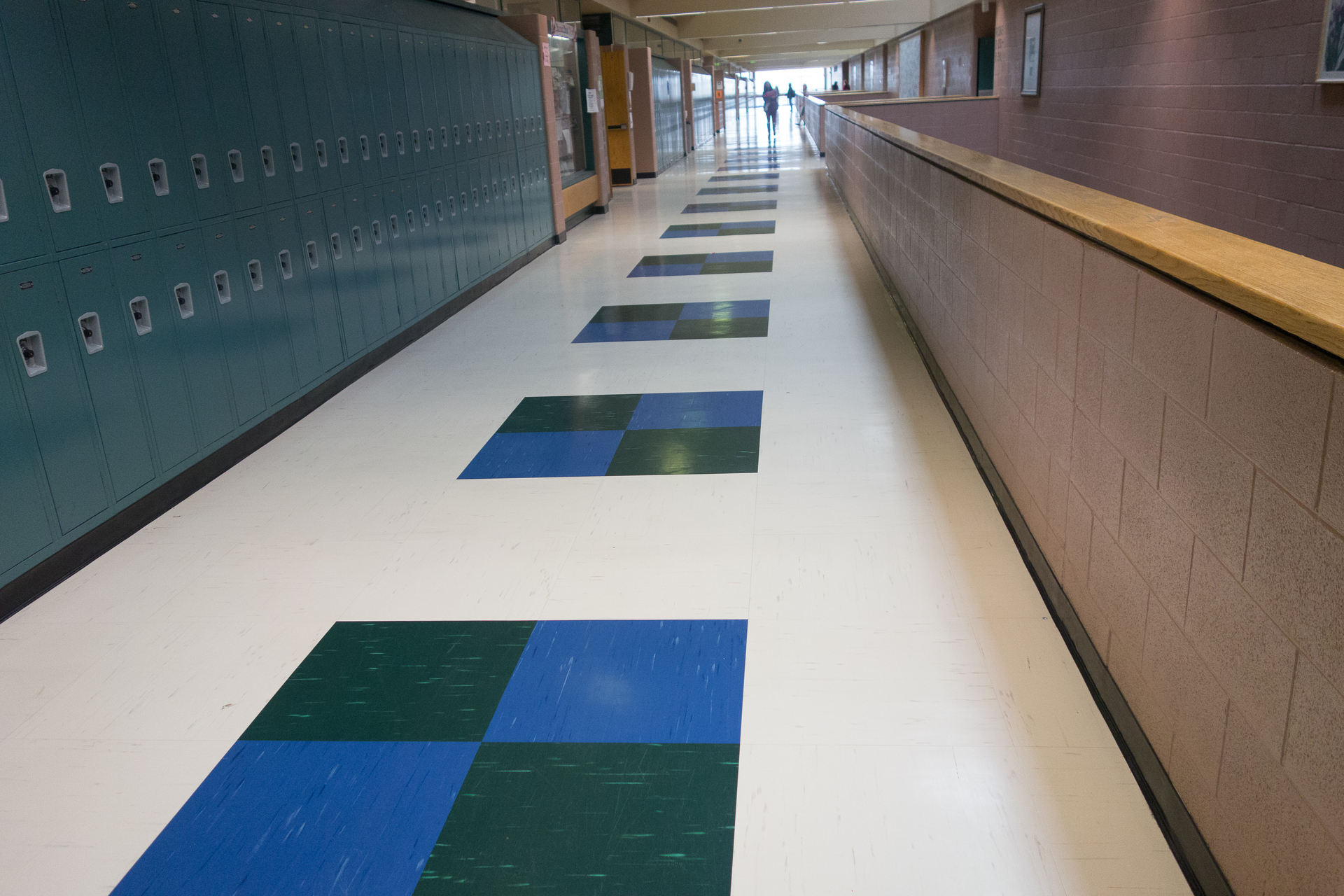Standley Lake High School features different colored tile faces that showcase the school's colors. Our quartz tile features Rikettseal™, a commercial-grade UV cured polyurethane coating that provides a durable, low-cost, no wax, easy maintenance flooring surface, which is ideal for high-traffic spaces.