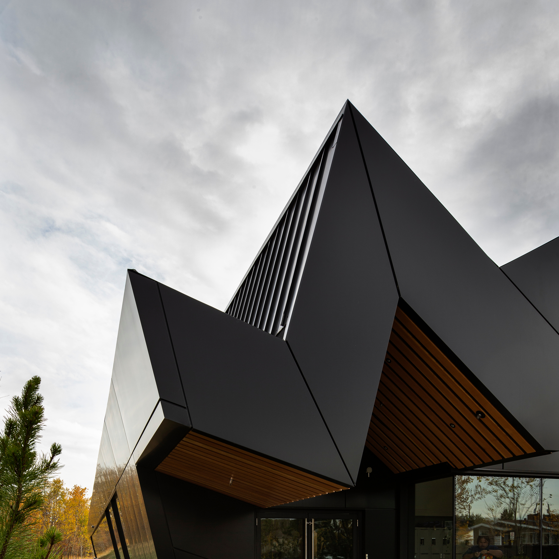 The 14,000 square-feet of metal panels are coated in a Valflon® finish supplied by Sherwin-Williams Coil Coatings in the color TOB Black.   This rich, vibrant and high-gloss color is a fluoropolymer FEVE resin-based coating that offers outstanding color consistency, protection against weathering, chalking, and fading, and excellent overall adhesion.   This finish also meets the highest performance standards, including AAMA 2605 specifications. The brilliant color depth of the Valflon coating allows the project to dynamically stand out.  Photography Credits: Jim Dobie Photography