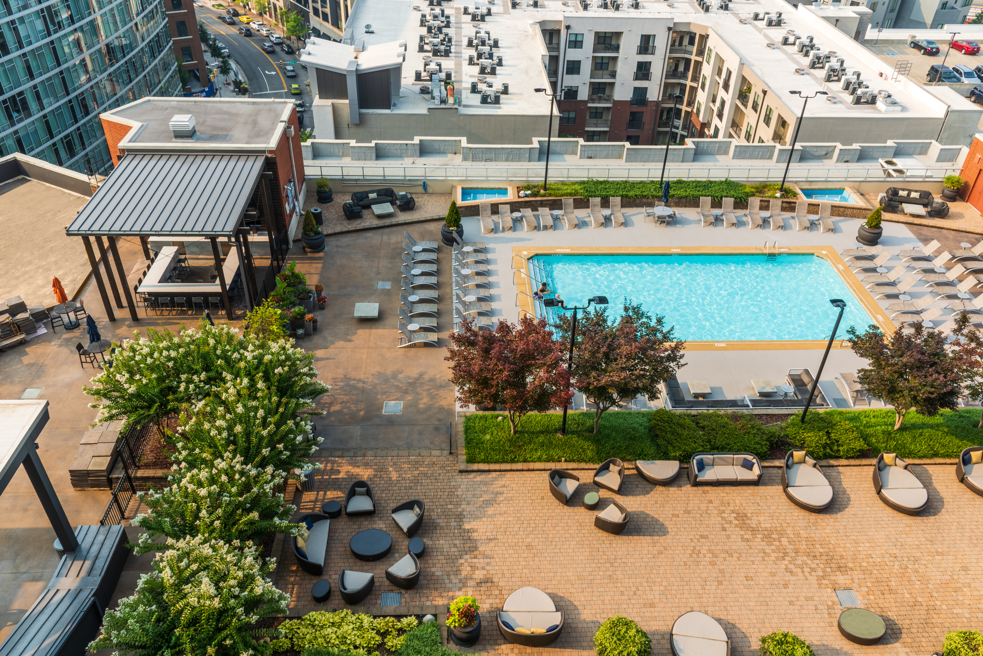The residents of this condo are able to enjoy the rooftop patio, bar and pool.  With lots of patio furniture, a pergola and a bar to enjoy refreshments for all.