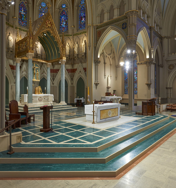 The steps to the altar feature marbelized rubber tile & tread by Roppe.