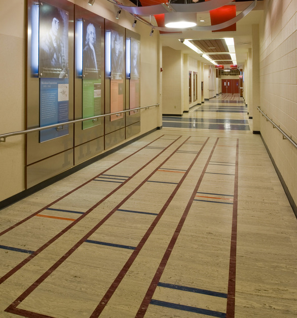 This high school hallway features marbelized rubber tile by Roppe.