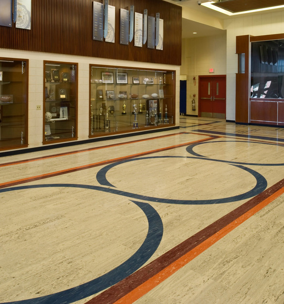A spacious common area featuring marbleized rubber tile by Roppe for lasting durability.