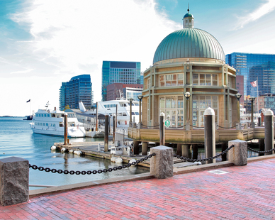 The restoration of Rowes Wharf on the East Cost city of Boston features the use of Belden Brick Regimental Red Full Range Permeable Pavers,  Ebony Black Beehive Series Pavers.