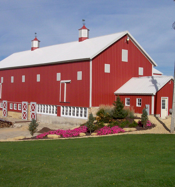 Huge Bright Red Barn with White roof and accents by Fabral.