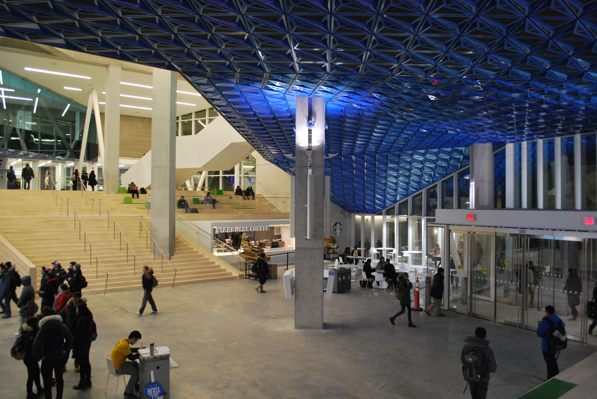 The finish of Sherwin-Williams Coil Coatings's Valflon Prismatic Blue on the metal panels evokes a molecular crystalline lattice as it might appear under a powerful microscope. The Prismatic Blue soffit extends into the SLC's spacious interior lobby and provides a continuous look.