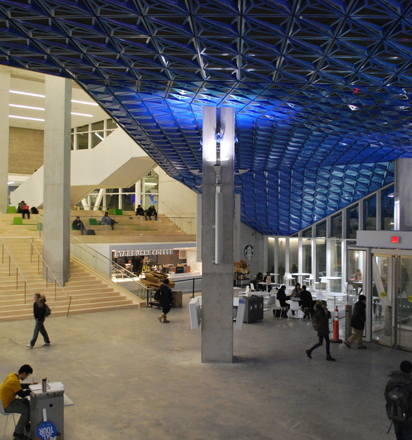 The finish of Sherwin-Williams Coil Coatings's Valflon Prismatic Blue on the metal panels evokes a molecular crystalline lattice as it might appear under a powerful microscope. The Prismatic Blue soffit extends into the SLC's spacious interior lobby and provides a continuous look.  Photography credits: Marcus Mitanis