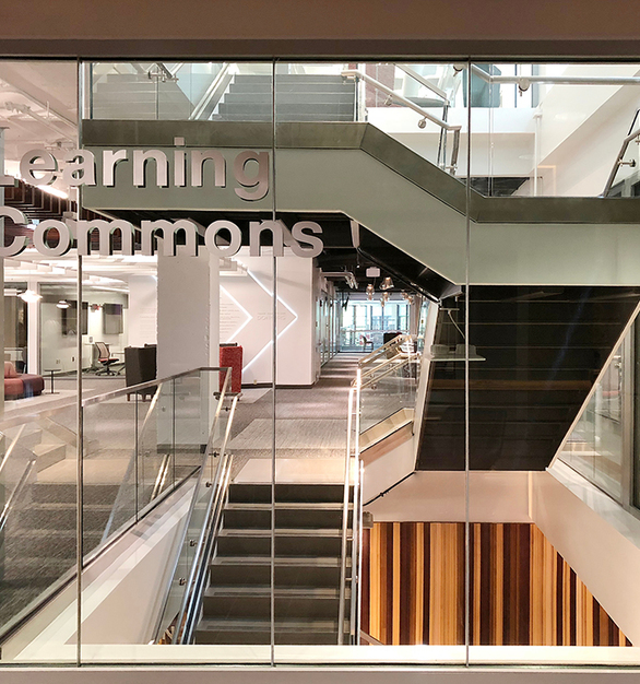 The Learning Commons at the University of Wisconsin School of Business features a modern frameless glass wall.