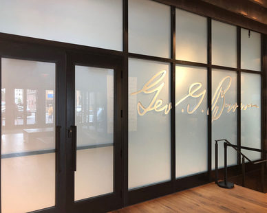 Stunning frosted glass wall gives the Old Forester retail space a sleek, modern feel.