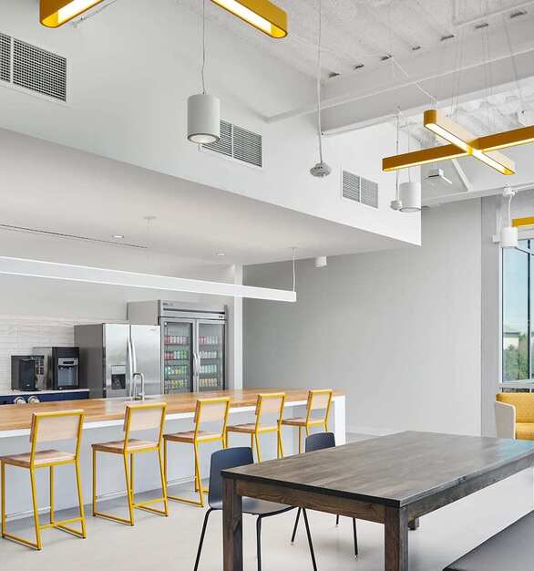 SailPoint Office Employee Breakroom Counter Seating Lighting and Tables